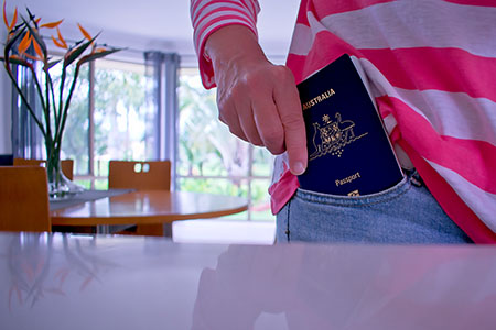 Citizenship page - passport in pocket shutterstock_1378075382